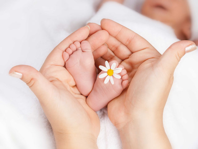 Baby Feet with a Flower